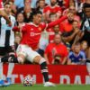 Ronaldo strike double in his Manchester United debut